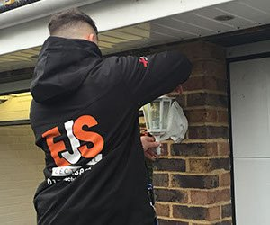 Man Fixing a Lamp | EJS Electrical