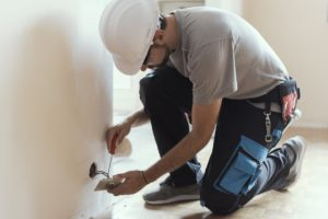 Electrician conducting electrical wiring inspection